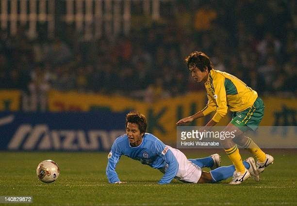 Takashi Fukunishi of Jubilo Iwata is tackled by Naotake Hanyu of JEF United Ichihara during the JLeague match between JEF United Ichihara and Jubilo...