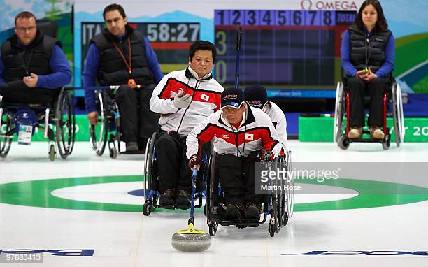 Takashi Hidai of Japan releases the stone during the Wheelchair Curling Round Robin game between Italy and Japan on day two of the 2010 Vancouver...