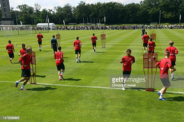 Takashi Inui and his team run during the training session of Eintracht Frankfurt at the training ground at Commerzbank Arena on July 3 2012 in...