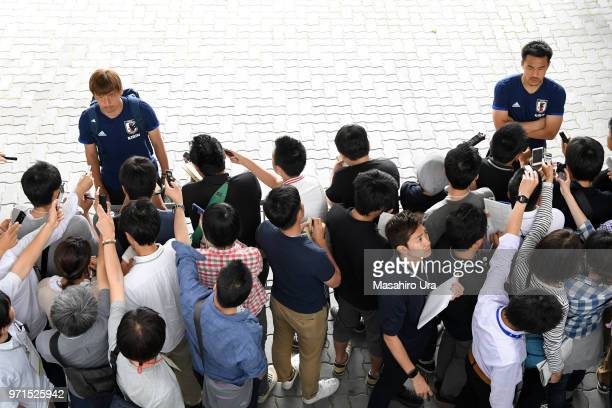 Takashi Inui and Shinji Okazaki of Japan speaks to the media after a training session ahead of the international friendly match between Japan and...