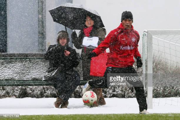 Takashi Inui controles the ball during a Eintracht Frankfurt training session at CommerzbankArena on February 19 2013 in Frankfurt am Main Germany