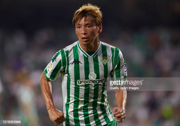 Takashi Inui of Betis looks on during the La Liga match between Real Betis Balompie and Levante UD at Estadio Benito Villamarin on August 17 2018 in...