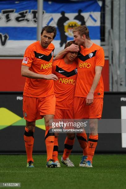 Takashi Inui of Bochum celebrates with teammates Christoph Dabrowski and Bjoern Kopplin after scoring his team's opening goal during the Second...