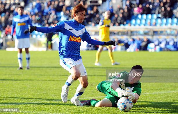 Takashi Inui of Bochum is challanged by goalkeeper Kevin Mueller of Rostock during the Second Bundesliga match between VfL Bochum and Hansa Rostock...