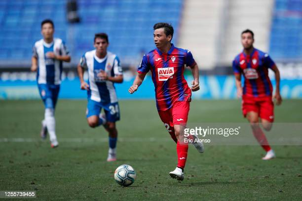 Takashi Inui of Eibar runs with the ball during the Liga match between RCD Espanyol and SD Eibar SAD at RCDE Stadium on July 12, 2020 in Barcelona,...