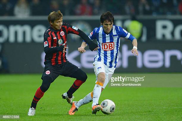 Takashi Inui of Eintracht Frankfurt and Hajime Hosogai of Hertha BSC battle for the ball during the Bundesliga match between Eintracht Frankfurt and...