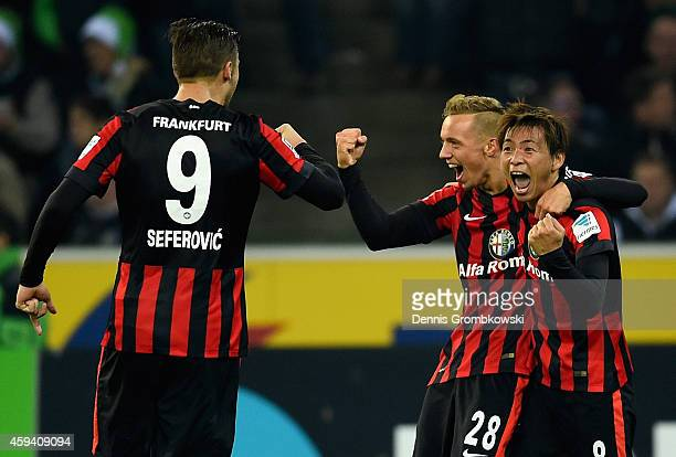 Takashi Inui of Eintracht Frankfurt celebrates as he scores their third goal during the Bundesliga match between Borussia Moenchengladbach and...