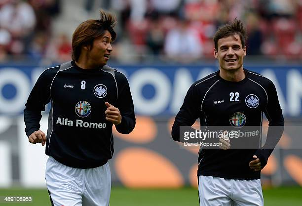 Takashi Inui of Frankfurt and Stefano Celozzi of Frankfurt warm up prior to the Bundesliga match between FC Augsburg and Eintracht Frankfurt at SGL...