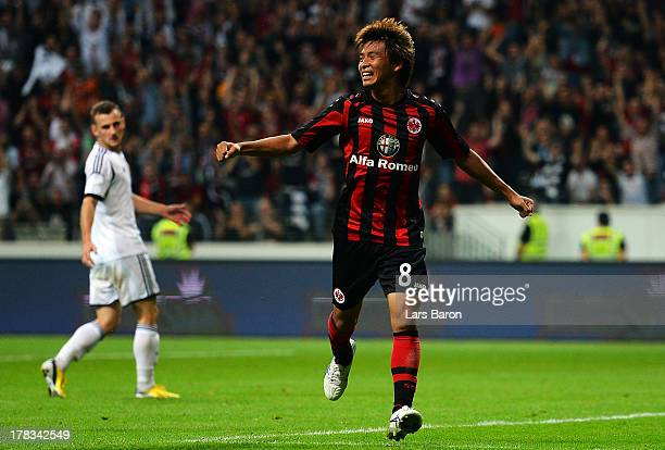 Takashi Inui of Frankfurt celebrates after scoring his teams second goal during the UEFA Europa League playoff second leg between Eintracht Frankfurt...