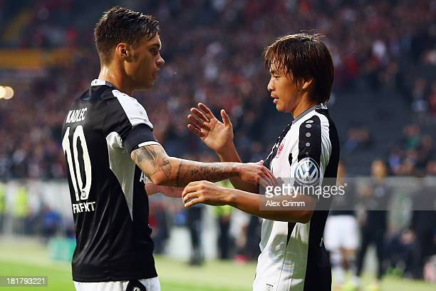 Takashi Inui of Frankfurt celebrates his team's first goal with team mate Vaclav Kadlec during the DFB Cup second round match between Eintracht...