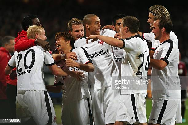 Takashi Inui of Frankfurt celebrates his team's second goal with team mates during the Bundesliga match between 1 FC Nuernberg and Eintracht...