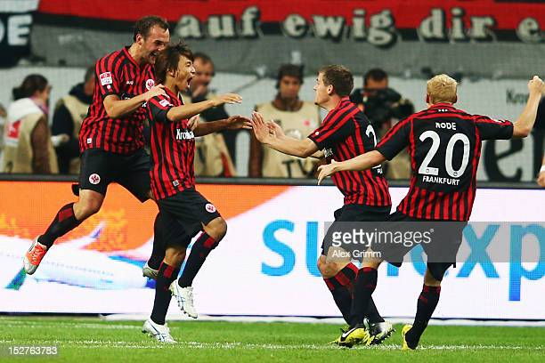 Takashi Inui of Frankfurt celebrates his team's second goal with team mates Stefan Aigner Sebastian Jung and Sebastian Rode during the Bundesliga...