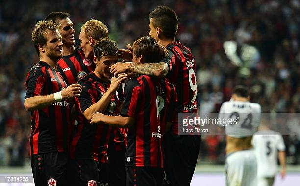 Takashi Inui of Frankfurt celebrates with team mates after scoring his teams second goal during the UEFA Europa League playoff second leg between...
