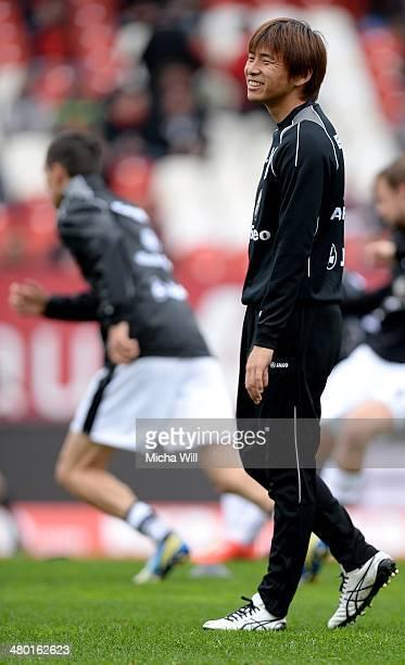 Takashi Inui of Frankfurt reacts prior to the Bundesliga match between 1 FC Nuernberg and Eintracht Frankfurt at Grundig Stadium on March 23 2014 in...
