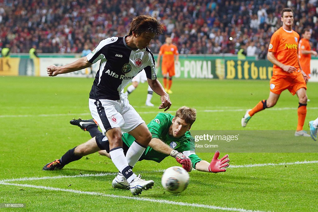 Takashi Inui of Frankfurt scores a disallowed goal against goalkeeper Andreas Luthe of Bochum during the DFB Cup second round match between Eintracht Frankfurt and VfL Bochum at Commerzbank-Arena on September 25, 2013 in Frankfurt am Main, Germany.