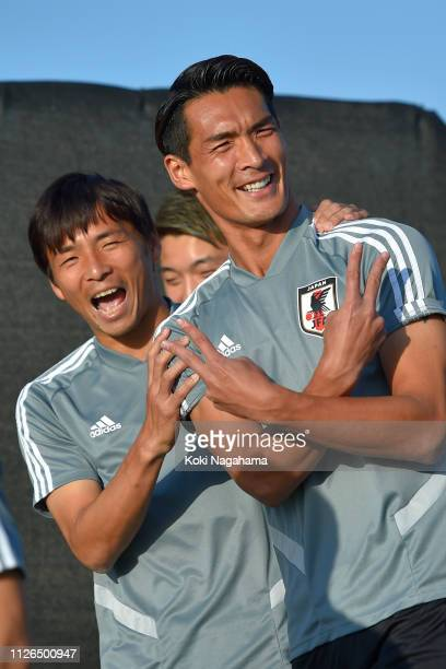 Takashi Inui of Japan and Tomoaki Makino of Japan attend the training session at Cricket training site 2 on January 31 2019 in Abu Dhabi United Arab...