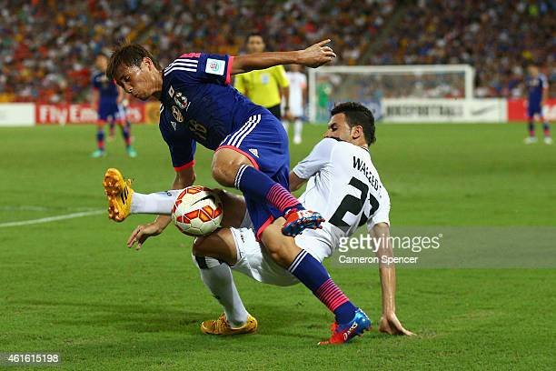 Takashi Inui of Japan and Waleed Salem AlLami of Iraq contest the ball during the 2015 Asian Cup match between Iraq and Japan at Suncorp Stadium on...