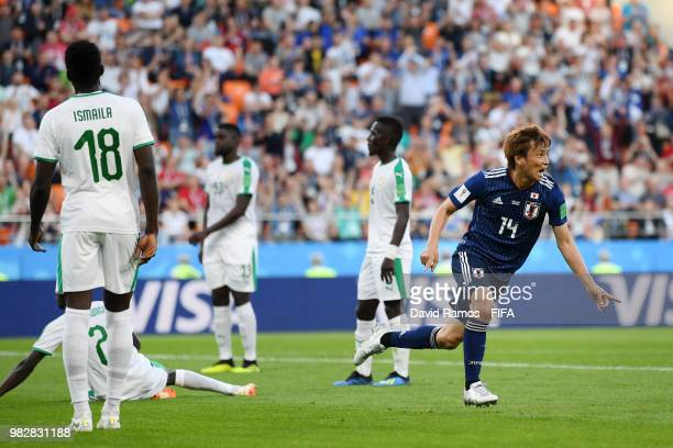 Takashi Inui of Japan celebrates after scoring his team's first goal during the 2018 FIFA World Cup Russia group H match between Japan and Senegal at...