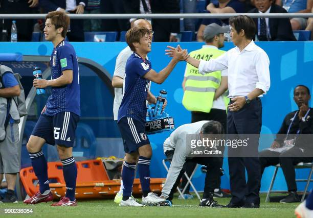 Takashi Inui of Japan celebrates his goal with his coach Akira Nishino during the 2018 FIFA World Cup Russia Round of 16 match between Belgium and...