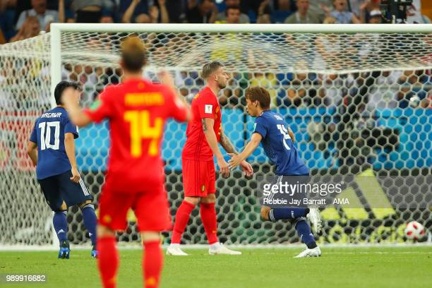 Takashi Inui of Japan celebrates scoring a goal to make it 0-2 during the 2018 FIFA World Cup Russia Round of 16 match between Belgium and Japan at...