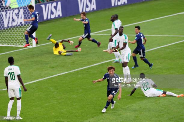 Takashi Inui of Japan celebrates scoring his side's first goal during the 2018 FIFA World Cup Russia group H match between Japan and Senegal at...