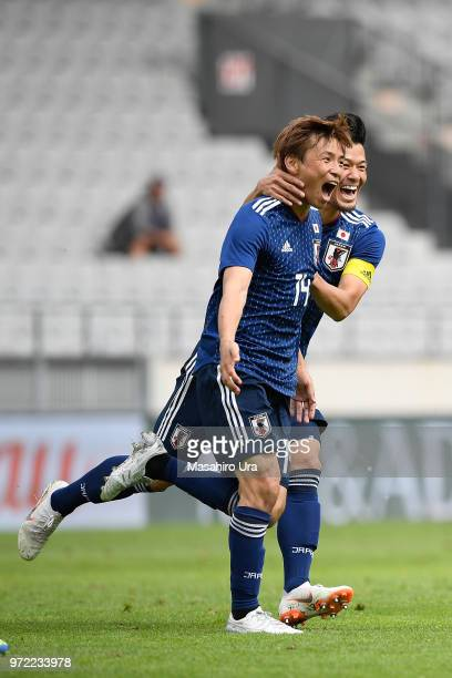 Takashi Inui of Japan celebrates scoring his side's first goal with his team mate Hotaru Yamaguchi during the international friendly match between...