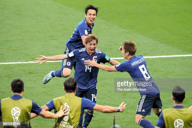 Takashi Inui of Japan celebrates scoring his side's second goal with his team mates during the 2018 FIFA World Cup Russia Round of 16 match between...
