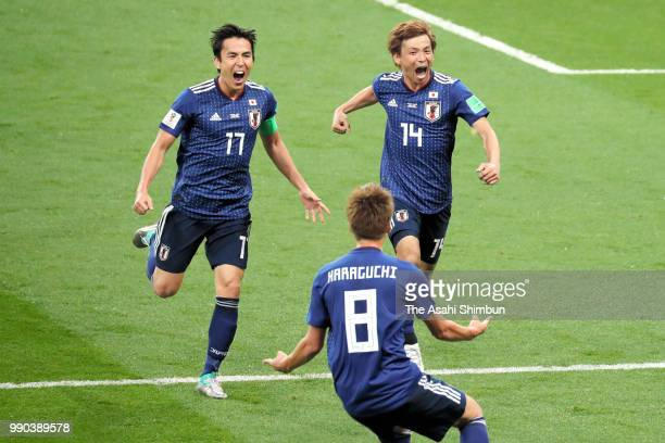 Takashi Inui of Japan celebrates scoring his side's second goal with his team mates Makoto Hasebe and Genki Haraguchi during the 2018 FIFA World Cup...