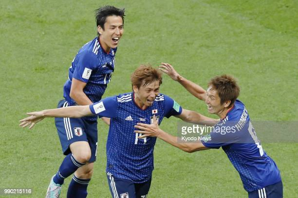 Takashi Inui of Japan celebrates with his teammates Genki Haraguchi and Makoto Hasebe after scoring their team's second goal during the second half...
