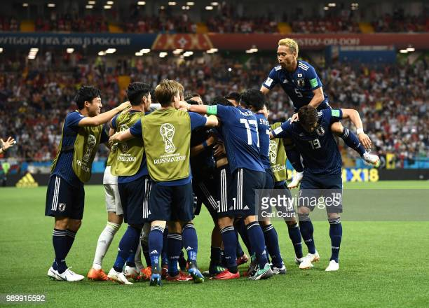 Takashi Inui of Japan celebrates with team mates after scoring his team's second goal during the 2018 FIFA World Cup Russia Round of 16 match between...