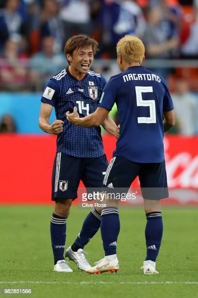 Takashi Inui of Japan celebrates with teammate Yuto Nagatomo after scoring his team's first goal during the 2018 FIFA World Cup Russia group H match...