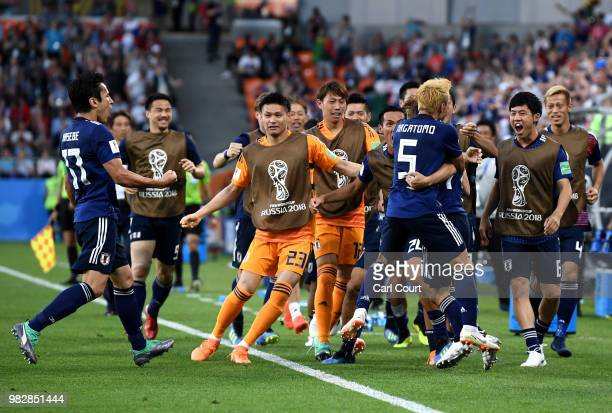 Takashi Inui of Japan celebrates with teammates after scoring his team's first goal during the 2018 FIFA World Cup Russia group H match between Japan...