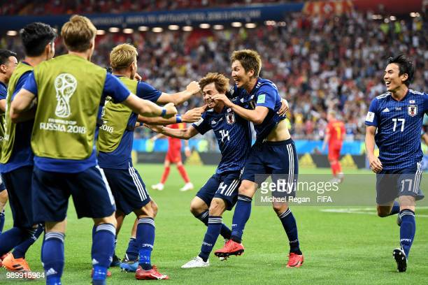 Takashi Inui of Japan celebrates with teammates after scoring his team's second goal during the 2018 FIFA World Cup Russia Round of 16 match between...