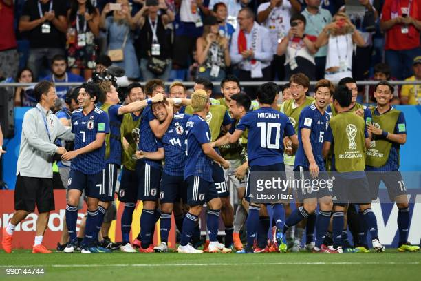 Takashi Inui of Japan celebrates with teammates after scoring his sides second goal during the 2018 FIFA World Cup Russia Round of 16 match between...
