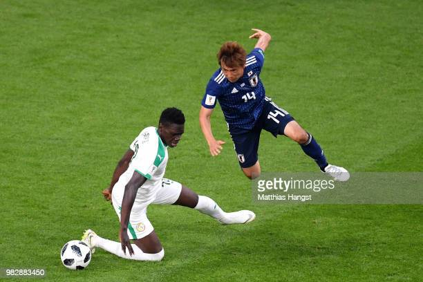 Takashi Inui of Japan challenge for the ball with Ismaila Sarr of Senegal during the 2018 FIFA World Cup Russia group H match between Japan and...