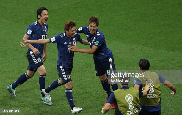 Takashi Inui of Japan is congratulated by team mate's after he scores his sides second goal during the 2018 FIFA World Cup Russia Round of 16 match...