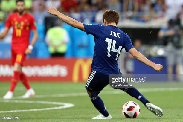 Takashi Inui of Japan kicks the ball to score his sides second goal during the 2018 FIFA World Cup Russia Round of 16 match between Belgium and Japan...