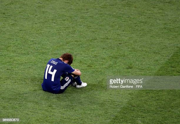 Takashi Inui of Japan looks dejected following his sides defeat in the 2018 FIFA World Cup Russia Round of 16 match between Belgium and Japan at...