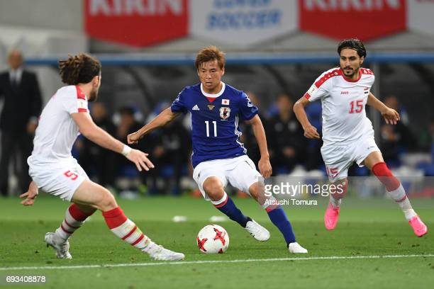 Takashi Inui of Japan runs with the ball during the international friendly match between Japan and Syria at Tokyo Stadium on June 7 2017 in Chofu...