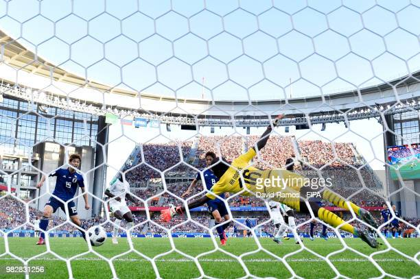 Takashi Inui of Japan scores past Khadim Ndiaye of Senegal his team's first goal during the 2018 FIFA World Cup Russia group H match between Japan...
