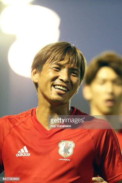 Takashi Inui of Japan with teamplayer in action during a training session ahead of the FIFA World Cup qualifier against Saudi Arabia at AlAhli Saudi...