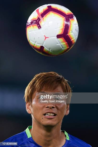 Takashi Inui of Real Betis warms up prior to the La Liga match between Real Betis Balompie and Levante UD at Estadio Benito Villamarin on August 17...