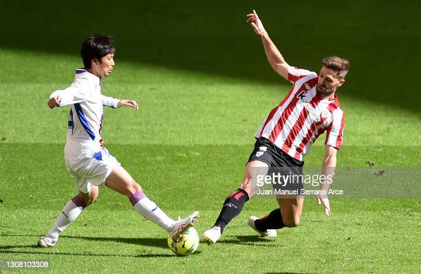 Takashi Inui of SD Eibar and Yeray of Athletic Bilbao battle for possession during the La Liga Santander match between Athletic Club and SD Eibar at...