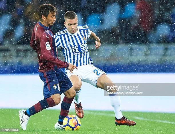 Takashi Inui of SD Eibar being followed by Kevin Rodrigues of Real Sociedad during the La Liga match between Real Sociedad and Eibar at Estadio...