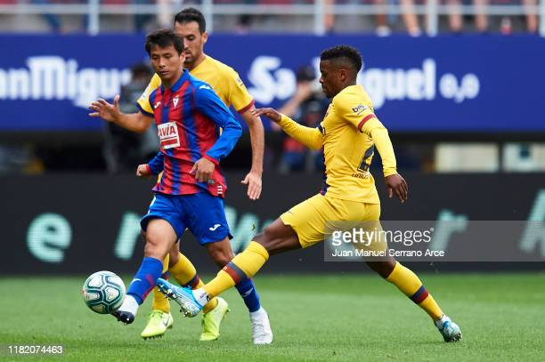 Takashi Inui of SD Eibar being followed by Nelson Semedo of FC Barcelona during the Liga match between SD Eibar SAD and FC Barcelona at Ipurua...