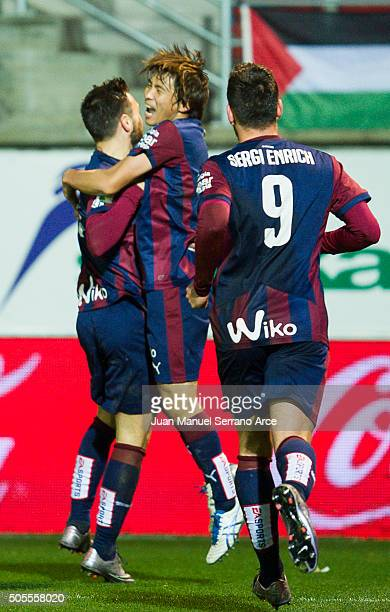 Takashi Inui of SD Eibar celebrates with his teammate Sergi Enrich and Antonio Luna of SD Eibar after scoring the opening goal during the La Liga...