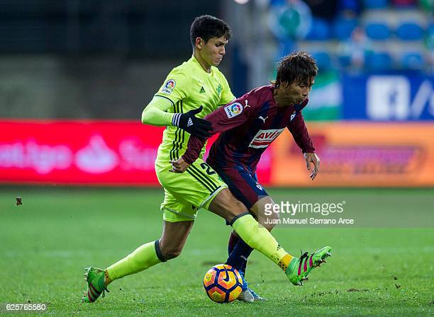 Takashi Inui of SD Eibar duels for the ball with Aissa Mandi of Real Betis during the La Liga match between SD Eibar and Real Betis Balompie at...