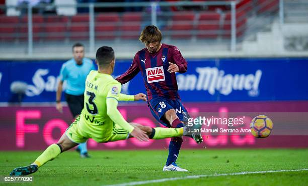 Takashi Inui of SD Eibar duels for the ball with Alex Martinez of Real Betis during the La Liga match between SD Eibar and Real Betis Balompie at...