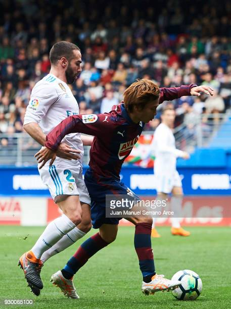 Takashi Inui of SD Eibar duels for the ball with Daniel Carvajal of Real Madrid during the La Liga match between SD Eibar and Real Madrid at Ipurua...