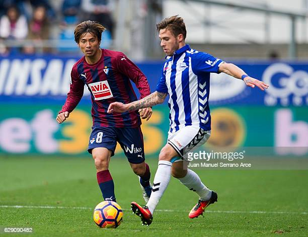 Takashi Inui of SD Eibar duels for the ball with Francisco Femenia of Deportivo Alaves during the La Liga match between SD Eibar and Deportivo Alaves...